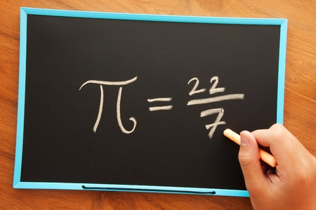 writing pi formula on chalkboard
