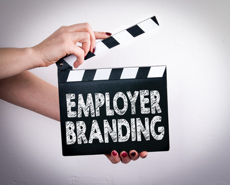 Employer Branding. Female hands holding movie clapper.
