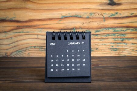 Photo for 2020 January. Black paper calendar on a wooden table - Royalty Free Image