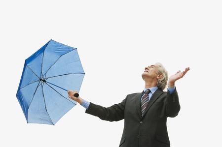 Germany, Hamburg, Businessman with umbrella