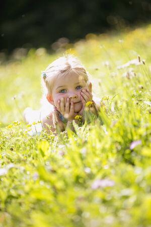 Young girl lying in meadow