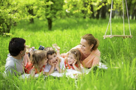 Happy family having picnic in nature