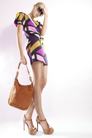 Photo for Young woman wearing patterned mini dress - Royalty Free Image