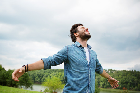 Photo for Emotional young man laughing in wind - Royalty Free Image