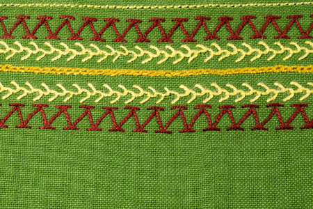 Embroidery on green linen