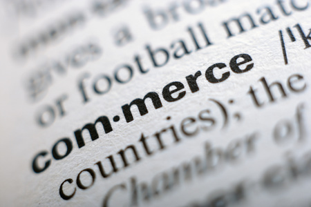 Extreme close up of english dictionary page with word commerce