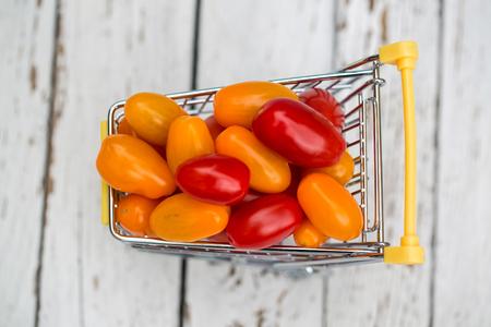 Miniature shopping cart with mini tomatoes