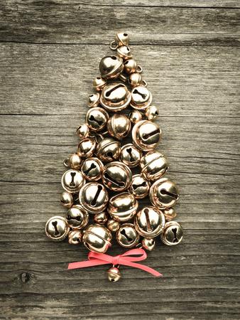 Foto für Bells, christmas tree on wood - Lizenzfreies Bild
