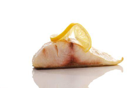 Cobia, fried fish filet with lemon slice