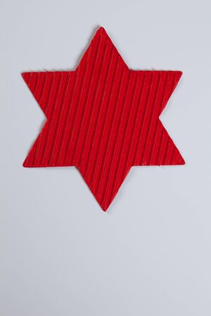 Red star, white background, copy space