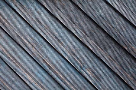 Diagonally riffled wood wall