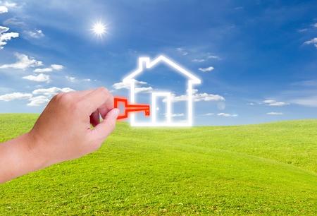 Photo pour hand holding key for house icon - image libre de droit