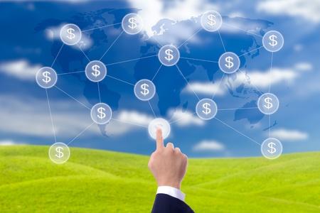 Photo pour business man hand pressing button of money network - image libre de droit
