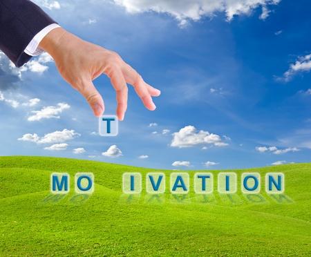 Photo pour business man hand made motivation word buttons on green grass meadow - image libre de droit