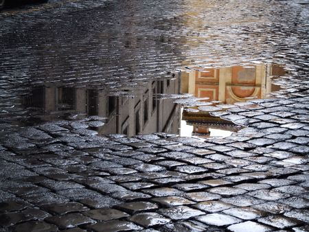 Cobblestone - old street in Rome (Italy). A view just after rain.