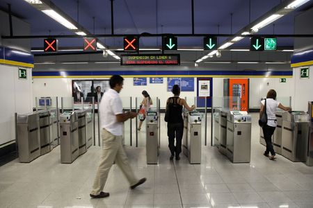 MADRID - SEPTEMBER 3: Metro station entrance turnstiles on September 3, 2009 in Madrid. Madrid Metro is among seven longest metro systems in the world.