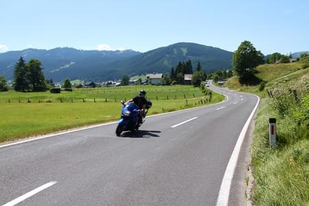 Motorbiking in Austrian Alps. Alpine landscape in Upper Austria. Road to Pass Gschutt.