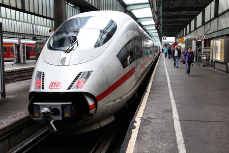 STUTTGART, GERMANY - JULY 24: Intercity Express (ICE) train of Deutsche Bahn on July 24, 2010 in Stuttgart, Germany. DB took over Arriva Plc company in August 2010. ICE 3 class train manufactured by Siemens.
