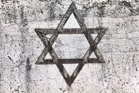Star of David - Jewish symbol on an old Hebrew grave in Milan, Italy.