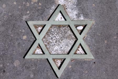 Star of David - Jewish symbol on an old Hebrew grave in Campo Verano cemetery, Rome.