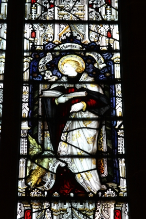 WOLVERHAMPTON, UK - MARCH 10: Stained glass Saint John Evangelist in St Peter's Collegiate Church on March 10, 2010 in Wolverhampton, UK. The famous church dates back to 12th century.
