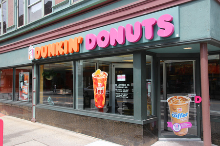 PROVIDENCE, USA - JUNE 8, 2013: Exterior of Dunkin Donuts shop in Providence. The company is the largest coffee and baked goods franchise in the world, with 15,000 stores in 37 countries.