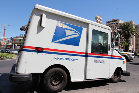 LAS VEGAS, USA - APRIL 14, 2014: United States Postal Service van in Las Vegas. USPS is the operator of the largest civilian vehicle fleet in the world.