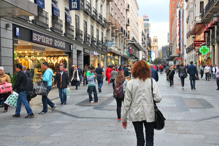 Photo for MADRID, SPAIN - OCTOBER 24, 2012: People shop downtown in Madrid. Madrid is a popular tourism destinations with 3.9 million estimated annual visitors (official data). - Royalty Free Image
