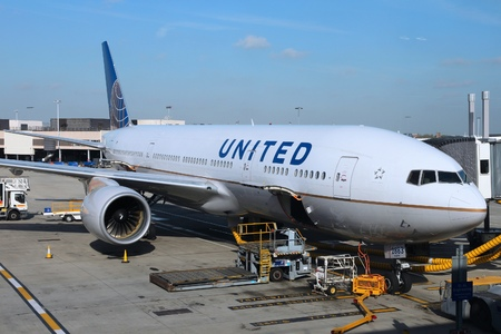 LONDON, UK - APRIL 16, 2014: United Airlines Boeing 777 at London Heathrow airport. United Airlines is the largest airline in the world by destinations served with 374 airports.