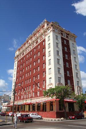 HAVANA, CUBA - FEBRUARY 24, 2011: People walk by Hotel Presidente in Havana, Cuba. Tourism in Cuba has grown considerably since the recent re-establishment of US-Cuba diplomatic relations.