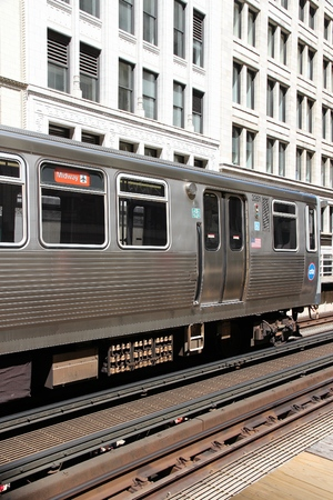 CHICAGO, USA - JUNE 28, 2013: Chicago's elevated train. El train system served 231 million rides in 2012.