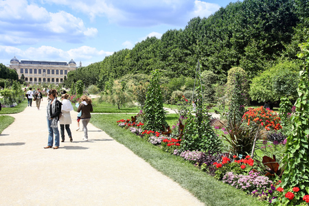 PARIS, FRANCE - JULY 24, 2011: People stroll in Garden of Plants in Paris, France. Garden of Plants is popular among tourists in Paris, most visited city worldwide (15.6 m international arrivals in 2011).