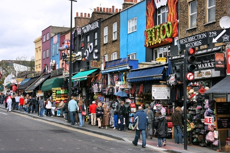 LONDON, UK - APRIL 12, 2008: People shop in Camden Town in London, UK. Camden Town is a London borough famous for its canals and alternative shopping culture.