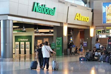 Photo pour LAS VEGAS, USA - APRIL 13, 2014: Alamo and National car rental airport office in Las Vegas. Both brands are owned by Enterprise Holdings, company employing 74,000 people (2013). - image libre de droit