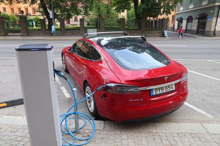 STOCKHOLM, SWEDEN - AUGUST 24, 2018: Tesla Model S electric car charging in Stockholm, Sweden. There are 520 registered vehicles per 1000 people in Sweden.