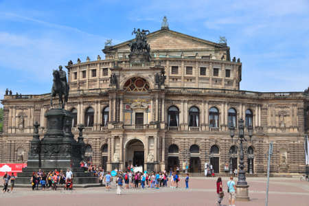 DRESDEN, GERMANY - MAY 10, 2018: People visit Semperoper (Opera House) in Altstadt (Old Town) district of Dresden, the 12th biggest city in Germany.