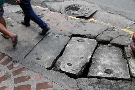 Photo for Hazardous city sidewalk in Manila, Philippines. Dangerous holes and damaged concrete. - Royalty Free Image
