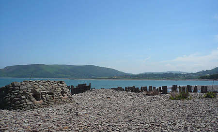 Wartime bunker and remains of sea defences, South West England