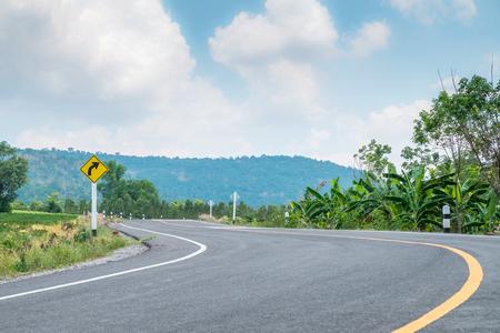 Sharp curve on the hill with asphalt road,blue sky background.