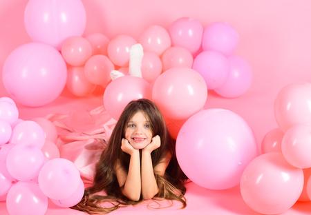 Kid in balloons, birthday. kid or little girl in pink balloons, birthday