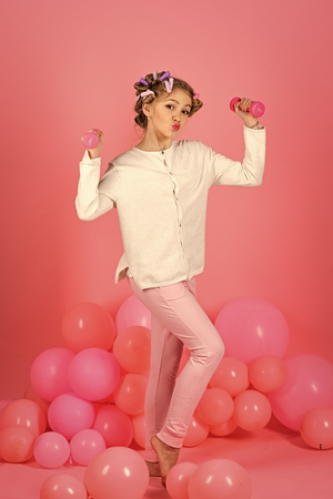 fitness, morning exercise, weight lifting, pink background.