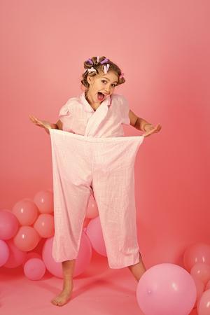 Pajama party balloons on pink studio background.
