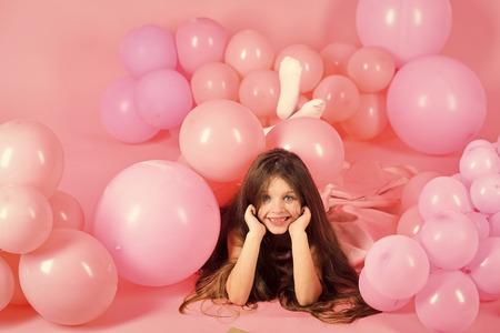 Child Childhood Children Happiness Concept. Kid in balloons, birthday.