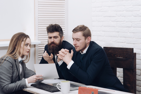 Business consulting concept. Lady lawyer or accountant consulting entrepreneurs. Business partners or businessmen at meeting, office background. Business negotiations, discuss conditions of deal