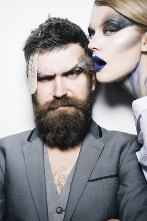 Visage course. Sensual woman and bearded man with creative makeup, visage course. Visage course of professional makeup. Visage course in beauty salon. Find your best look here.