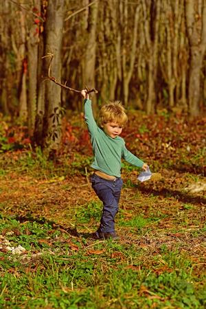 Baby boy play in spring park. Adorable baby age boy enjoy sunny day outdoor.