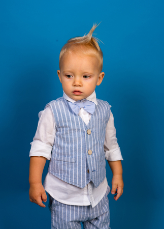 A classic never goes out of style. Small child. Boy child with fashion look. Small baby in fashionable wear. Fashion boy. Adorable fashionist. Childrens fashion trends.