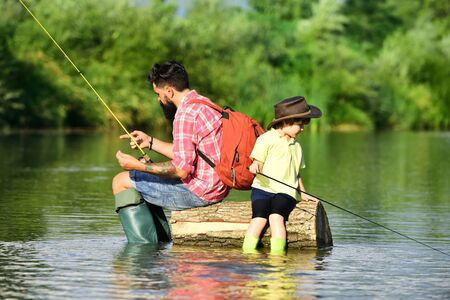 Photo pour Father and son fishing. Anglers. Father and son relaxing together - image libre de droit