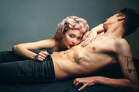 Photo pour Fashion photo of beautiful sexy couple posing at studio. Passionate heterosexual couple hugging isolated on white. Relax. Close up portrait. Relationship. Family. Romantic and love. - image libre de droit