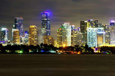 Photo for Miami business district, lights and reflections of the city lights. Miami night downtown, city Florida. - Royalty Free Image